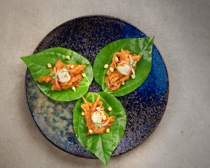 The Wine Rack - Raan Kolahapuri served on a betal leaf, boondi, pickled onion, avocado raita (1)